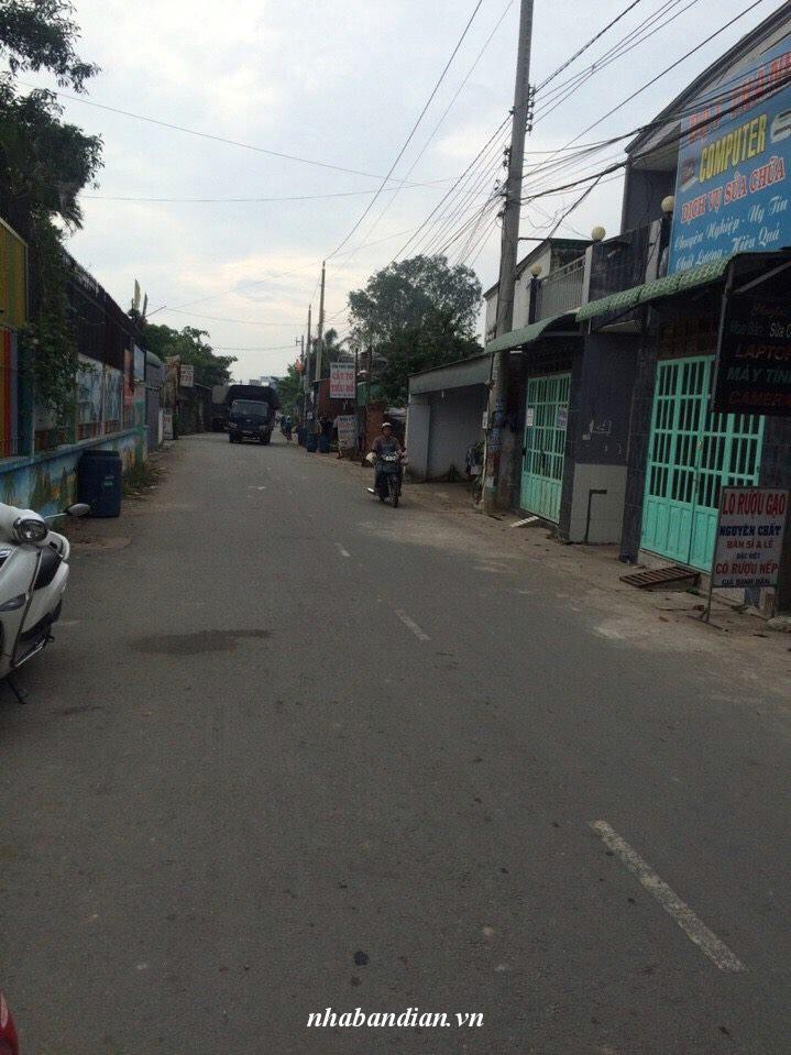 Bán nhà lầu và 6 phòng trọ đường Nguyễn Bính gần chợ Dĩ An