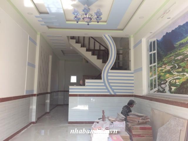 Bán nhà lầu 60m2 gần ngay trường tiểu học Dĩ An đường Nguyễn An Ninh vào 300m
