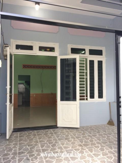 Bán nhà dĩ an giá rẻ sổ hồng riêng 50m2 gần chợ Tân Long
