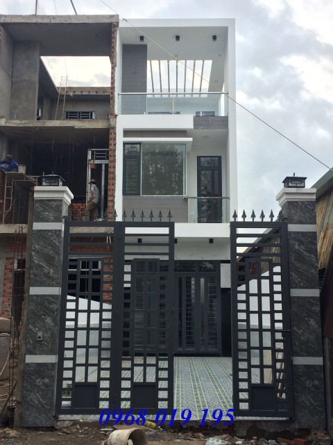 Bán nhà mặt tiền nhựa hai lầu 100m2 view bờ sông gần chợ Bình An