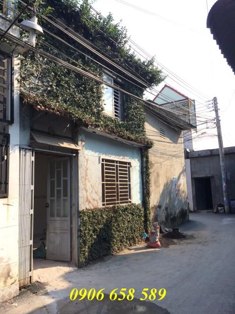 Bán nhà lầu 41m2 mặt tiền nhựa gần chợ Tân Long giá 880 triệu